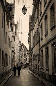 Old street in France in sepia