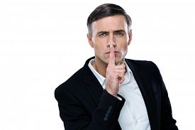 picture of shhh  - Businessman placing finger on lips saying shhh - JPG