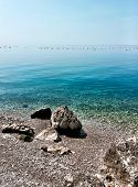 stock photo of naturist  - A sunny day in a Stunning Naturist Beach in Trieste Italy  - JPG