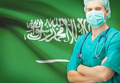 image of saudi arabia  - Surgeon with national flag on background  - JPG