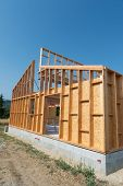 picture of framing a building  - Frame of building a wooden house - JPG