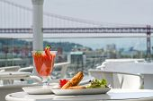 pic of samosa  - samosa and strawberry juice in coffe table with bridge view on background - JPG