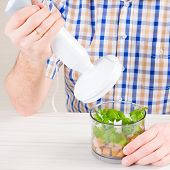 foto of blender  - Man using a hand blender to make a pate - JPG