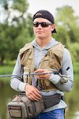 picture of catch fish  - Fishing in river - JPG