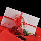 stock photo of rose close up  - beautifu rose chocolate and letter on red close up - JPG