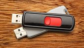 pic of usb flash drive  - Usb flash drives on the wooden background - JPG