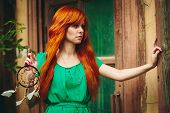 pic of redhead  - Creative Portrait of Redhead Young Woman in Green Dress with DreamCatcher in her Hands - JPG