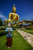 image of traditional dress  - Big Buddha Image with welcome boy statue in Thai traditional dress - JPG