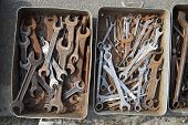 stock photo of locksmith  - Old locksmith tools are in a old metal box - JPG