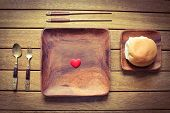 stock photo of bread rolls  - A love heart in the centre of a square plate with a bread roll  - JPG