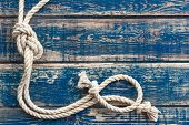 foto of marines  - Vintage wooden background with knotted marine rope - JPG