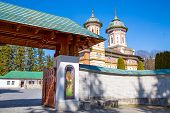picture of gates heaven  - The entrance gate to the Orthodox Sinaia Monastery and the partial view of the church inside - JPG