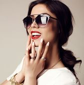 Beautiful Smiling Girl With Dark Hair With Sunglasses And Bijou poster