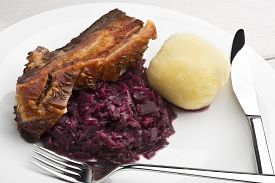 foto of pork belly  - Pork belly roast with caraway seasoned crackling red sauerkraut and German style potato dumpling - JPG