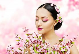 stock photo of japan girl  - Woman Flowers Bunch Pink Sakura Girl Makeup Beauty Portrait Asian Model Fashion Face Make up Floral Background - JPG