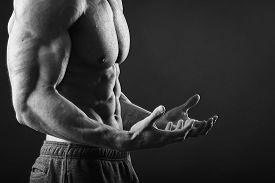 pic of macho man  - Muscular man bodybuilder - JPG