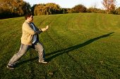 stock photo of shotokan  - shotokan karate training in park in the afternoon - JPG