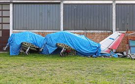 picture of tarp  - Light Aircrafts Grounded and Covered With Tarp - JPG