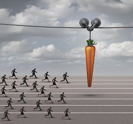 pic of employee  - Employee incentive business concept as a group of businessmen and businesswomen running on a track towards a dangling carrot on a moving cable as a financial reward metaphor to motivate for a goal - JPG