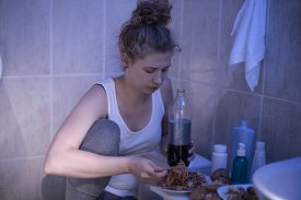pic of bulimic  - Photo of sick and sad young female eating unhealthy - JPG