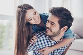 Happy Together. Beautiful Couple Of Young Cheerful  Lovers Are Hugging Indoors At Home With Love And poster