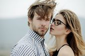 Sexy Girl In Stylish Glasses Looking At Handsome Man poster