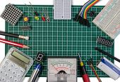 Diy Electrical Maker Tools Components On Green Cutting Mat Board. Diy Electrical Maker Tools With Co poster