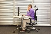 correct sitting position at workstation. man on chair working with pc poster