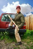 a redneck man with an ax in his hands
