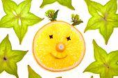 Starfruit (carambola) slices with orange face on white background