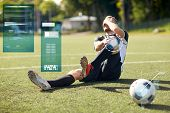 sport, sports injury and people - injured soccer player with ball on football field poster