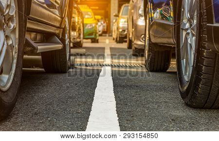 poster of Asphalt Parking Lot Of The Airport Or Shopping Mall. Car Parking Area For Rent. Closeup Wheel Of Man