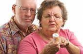 Senior Couple With Perscription Bottle
