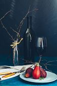 Traditional Dessert Pears Stewed In Red Wine With Chocolate Sauce On Plate On Blue Concrete Surface. poster