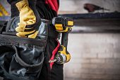 Construction Contractor Worker Closeup Photo. Tools Belt And Power Tool. Remodeling Concept. poster