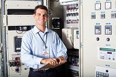 picture of electricity meter  - portrait of industrial engineer in front of computerized machinery - JPG