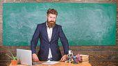 Teacher Interesting Interlocutor As Authority. Teacher Charismatic Hipster Stand Near Table Classroo poster