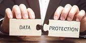 Businessman Collects Wooden Puzzles With The Word Data Protection. Denied Access To Confidential Inf poster
