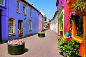 Quaint Street Lined With Vibrant Colorful Buildings In The Old Town Of Kinsale, County Cork, Ireland poster