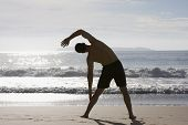 Man Doing Exercises On Beach
