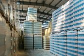 Large Modern Storehouse With Some Goods. Factory Building Or Warehouse Building With Packed Goods Re poster