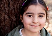 Close Up Portrait Of A Smiling Happy Little Girl