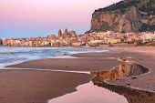 Beautiful Panoramic View Of The Beach, Cefalu Cathedral And Old Town Of Coastal City Cefalu At Sunse poster