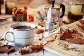 Coffee Mug, Chocolate, Coffee Beans, Cinnamon Sticks And Spices On White Wooden Table. Good Morning  poster