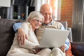 Senior Couple Browsing The Internet Together poster