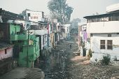 A Stinking Sewage Flow In The Slums. Poor Area Of Haridwar, India. House Poor People On The Hillside poster
