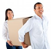 Couple packing in boxes to move house - isolated over a white background