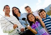 picture of golf  - Portrait of a beautiful happy family playing golf - JPG
