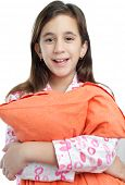 Beautiful hispanic girl wearing pajamas and holding a pillow isolated on white