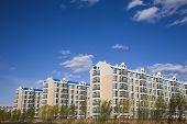 Modern apartment buildings under blue sky